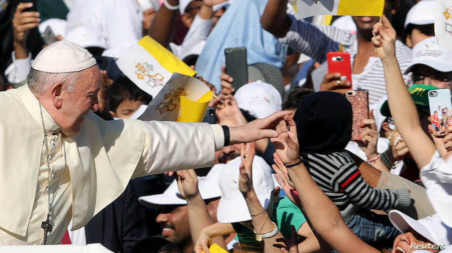 Pope Francis is greeted as he arrives to hold a mass at Zayed Sports City Stadium in Abu Dhabi, United Arab Emirates, February 5, 2019.