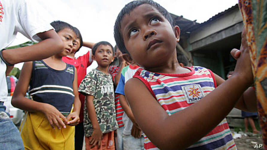 Two-year-old Arfaisal Marsaleh, a stateless child, holds on to his mother in a slum village in Kinarut, in Malaysia's Sabah state on Borneo island (file photo).