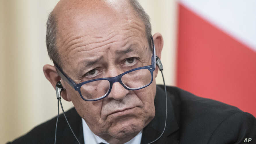 France's Foreign Minister Jean-Yves Le Drian listens during a news conference after his talks with Russian counterpart Sergey Lavrov, in Moscow, Sept. 8, 2017.Russia France