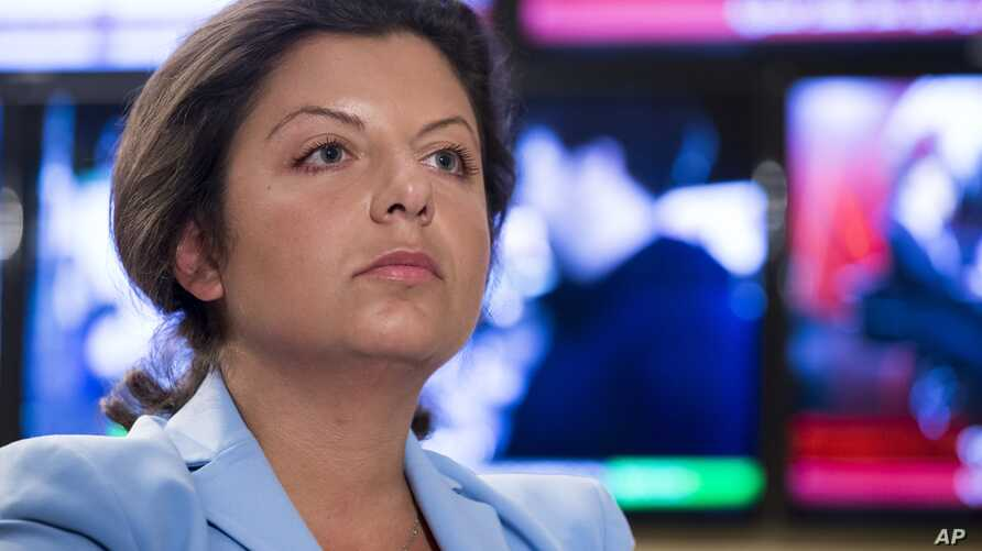 Margarita Simonyan, the head of the Russian television channel RT, listens to a question during her interview with the Associated Press in Moscow, Russia, , Jan. 19, 2018. Simonyan, the head of Russian television channel RT, which U.S. intelligence
