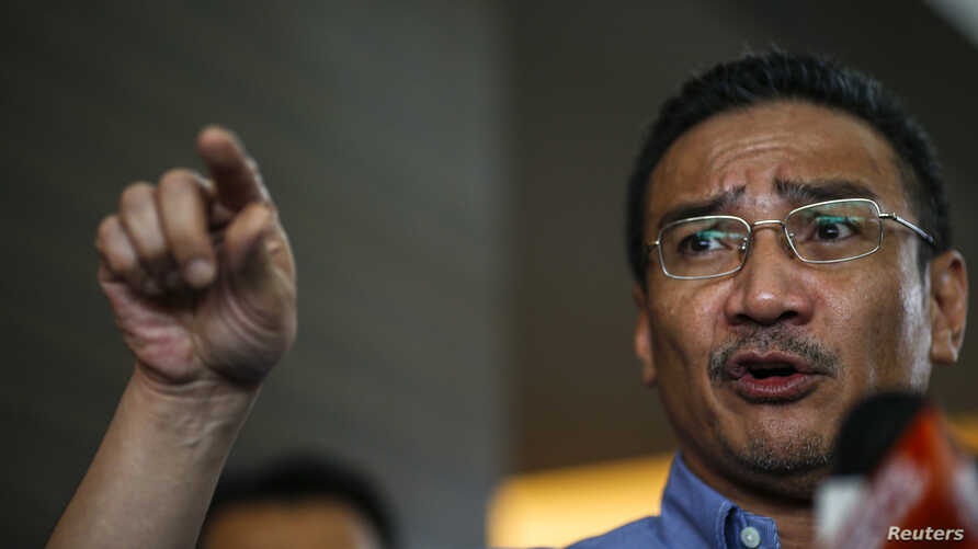Malaysia's acting Transport Minister Hishammuddin Hussein gestures as he speaks about the search for the missing Malaysia Airlines Flight MH370, during a news conference at The Everly Hotel in Putrajaya, March 29, 2014.