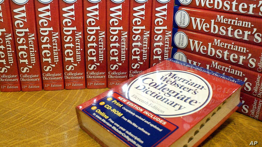 FILE -  Merriam-Webster's Collegiate Dictionary are seen at the company's headquarters office in Springfield, Mass.,