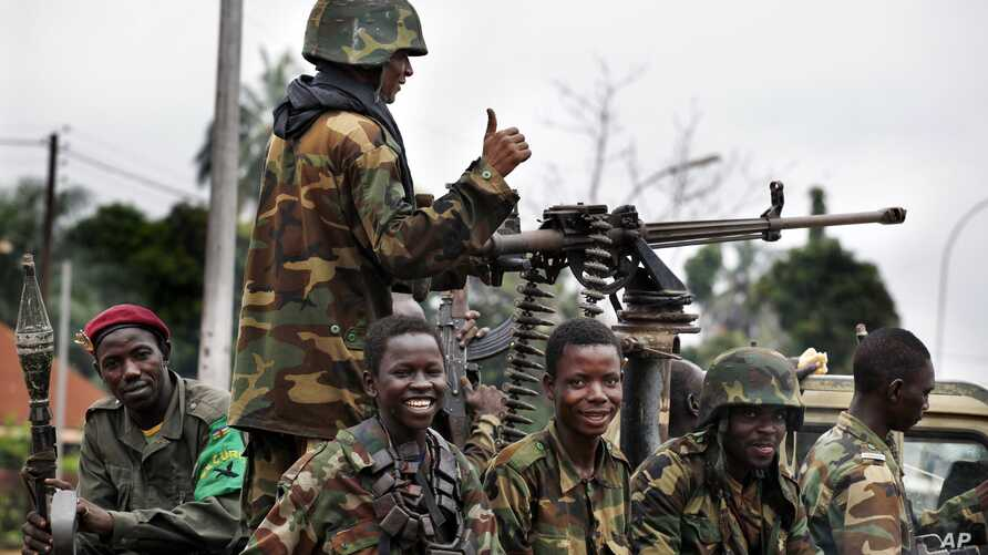 Seleka soldiers sit in a pick-up truck in Bangui, Central African Republic, Dec. 6, 2013.