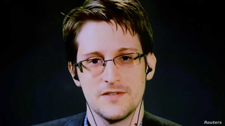 American whistleblower Edward Snowden delivers remarks via video link from Moscow to attendees at a discussion regarding an International Treaty on the Right to Privacy, Protection Against Improper Surveillance and Protection of Whistleblowers in Man