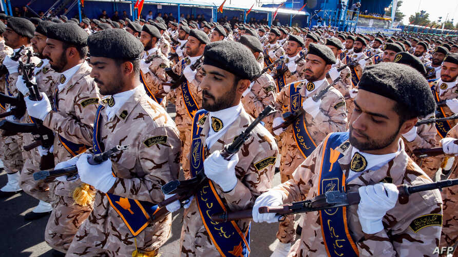 Members of Iran's Revolutionary Guards Corps (IRGC) march during the annual military parade marking the anniversary of the outbreak of the devastating 1980-1988 war with Saddam Hussein's Iraq, in the capital Tehran, Sept. 22, 2018.