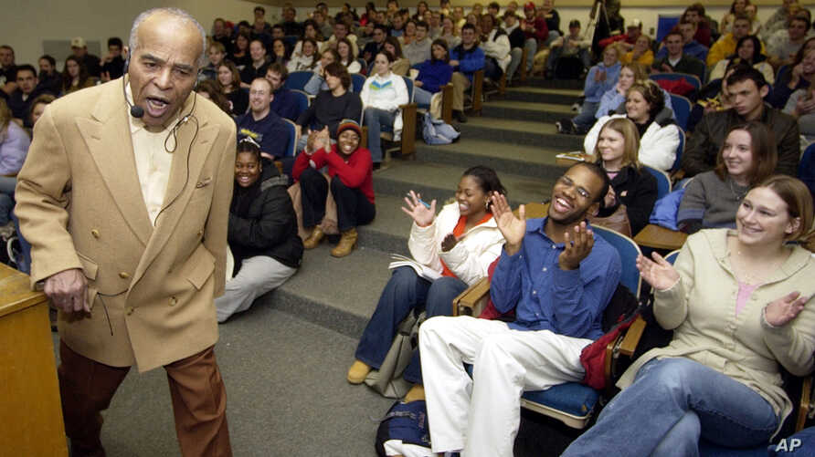 FILE - Jazz singer Jon Hendricks gets an ovation as he sings for his History of Jazz class at the University of Toledo, Jan. 13, 2004, in Toledo, Ohio. Hendricks died Nov. 22, 2017, in New York at age 96.
