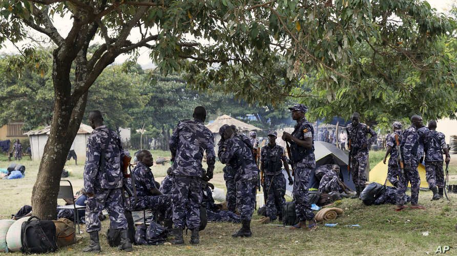 Members of the Uganda People's Defense Force gather in the town of Kasese, Uganda, Monday, Nov. 28, 2016. Rights groups on Monday urged Ugandan security forces to show restraint as they crack down on the members of a tribal militia.