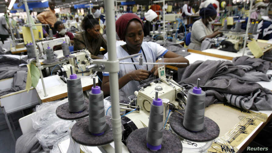 FILE - Kenyan workers prepare clothes for export at a factory in Athi River, near the Kenyan capital, Nairobi, July 31, 2009.