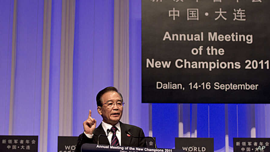 Chinese Premier Wen Jiabao speaks at World Economic Forum at the Dalian World Expo Center in Dalian, in northeast China's Liaoning Province, September 14, 2011.