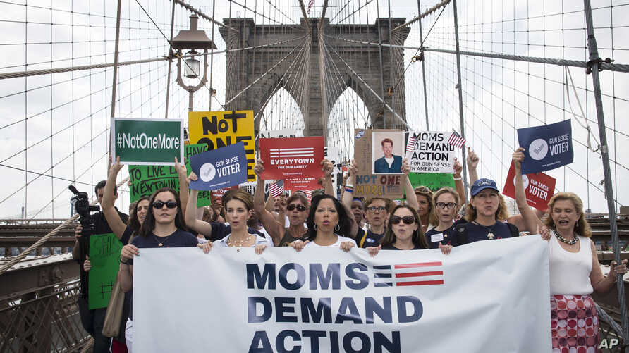 FILE - Hundreds of demonstrators march across the Brooklyn Bridge to call for tougher gun control laws, June 14, 2014, in New York.