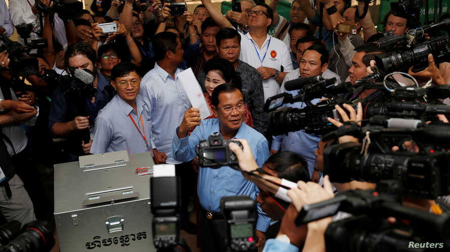 Cambodia's Prime Minister and President of the Cambodian People's Party (CPP) Hun Sen prepares to cast his vote at a polling station during a general election in Takhmao, Kandal province, Cambodia, July 29, 2018.