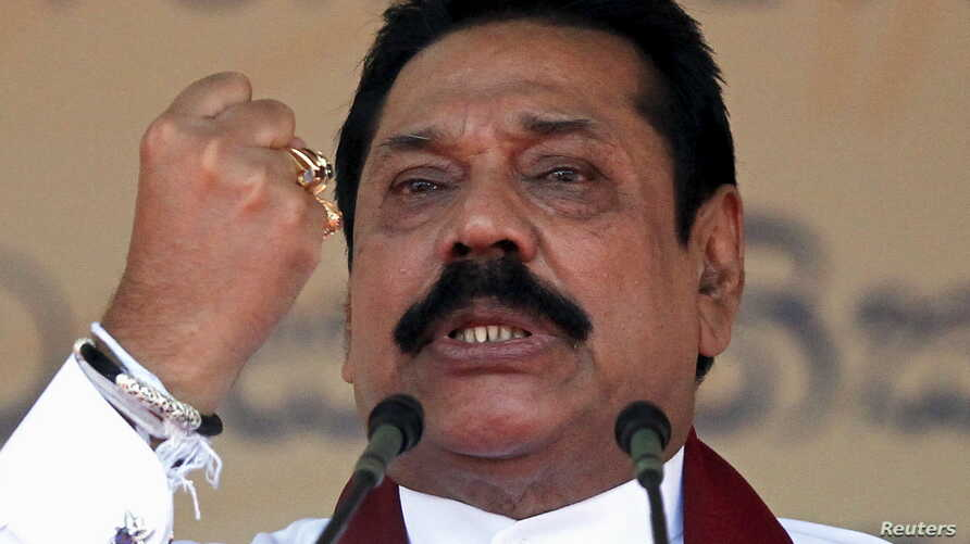 Sri Lanka's former president Mahinda Rajapaksa, who is contesting in the upcoming general election, speaks during the launch ceremony of his manifesto, in Colombo July 28, 2015.