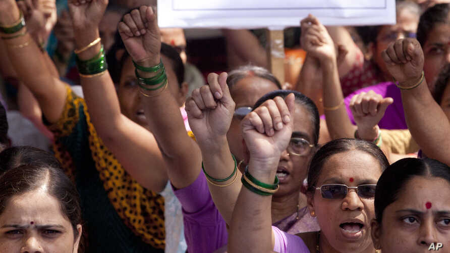 Activist of Hindu Janajagruti Samiti, or Hindu Awareness Forum, shout slogans against the blocking of their web-portal in Mumbai, India in the government's attempts to block social media accounts and websites, August 24, 2012.