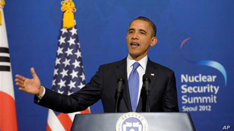 President Barack Obama speaks during a news conference with South Korean President Lee Myung-bak at the Blue House, the official presidential house, in Seoul, South Korea, Sunday, March 25, 2012.