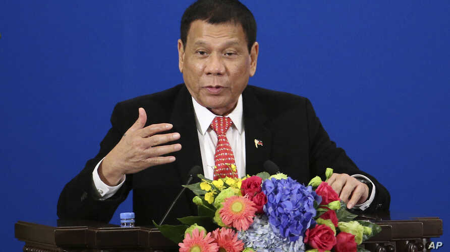 Philippine President Rodrigo Duterte delivers a speech during the Philippines-China Trade and Investment Forum at the Great Hall of the People in Beijing, Oct. 20, 2016.