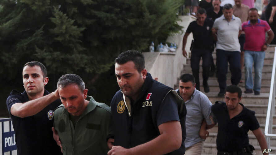 Members of Turkey armed forces are escorted by police for their suspected involvement in Friday's attempted coup at the court house in Mugla, a Mediterrenean city of Turkey, July 17, 2016.
