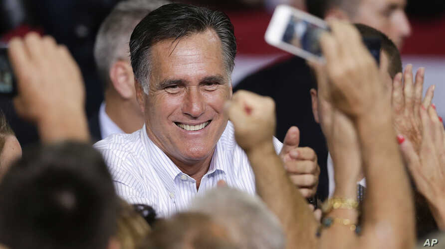 Republican presidential candidate Mitt Romney greets supporters after speaking at a rally in Las Vegas, September 21, 2012.