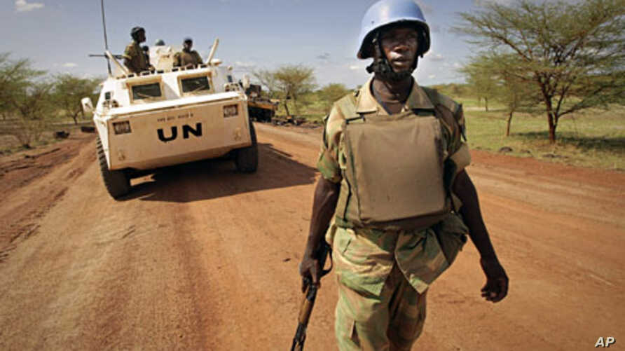 A UN handout picture shows a soldier from Zambia serving with the international peacekeeping operation on patrol in the region of Abyei (File)