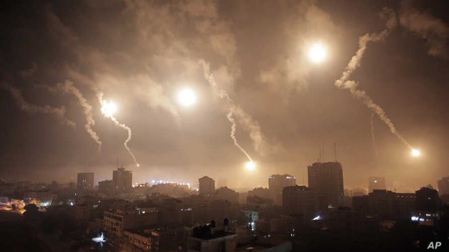 Israeli forces' flares light up the night sky over Gaza City on July 29, 2014.