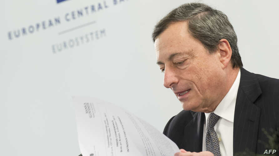 President of the European Central Bank (ECB) Mario Draghi looks at his notes during a press conference after the ECB Governing Council Meeting in Brdo, 60 km northeast of Ljubjana, October 4, 2012.