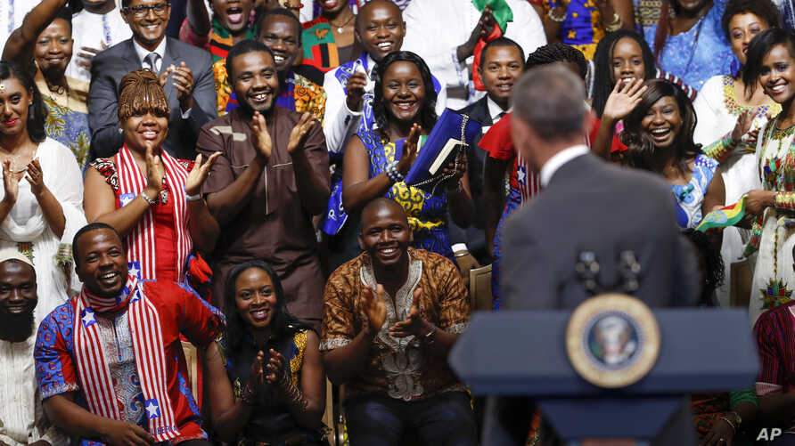"""President Barack Obama is welcomed by the Young African Leaders Initiative as they shout """"happy birthday,"""" in Washington, Aug. 3, 2016."""