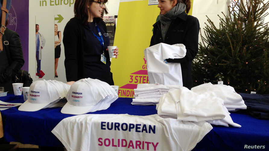 Youths attend the launch of the European Solidarity Corps, a new initiative for young people to travel and help out people in difficulty across the continent, outside the European Commission headquarters in Brussels, Belgium, Dec. 7, 2016.