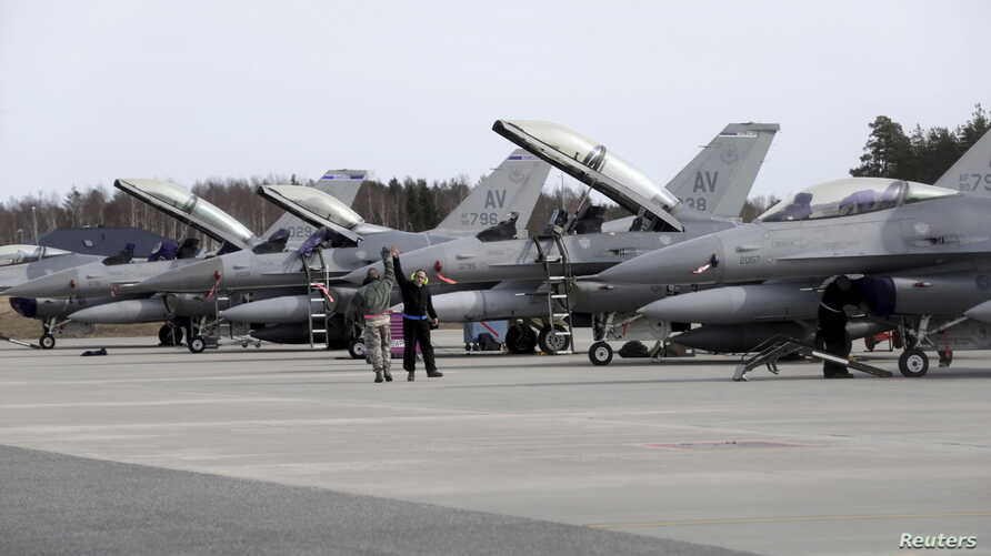 FILE - U.S. Air Force 510th Fighter Squadron F-16 fighters are seen parked on tarmac in Amari air base, in Estonia, March 26, 2015.