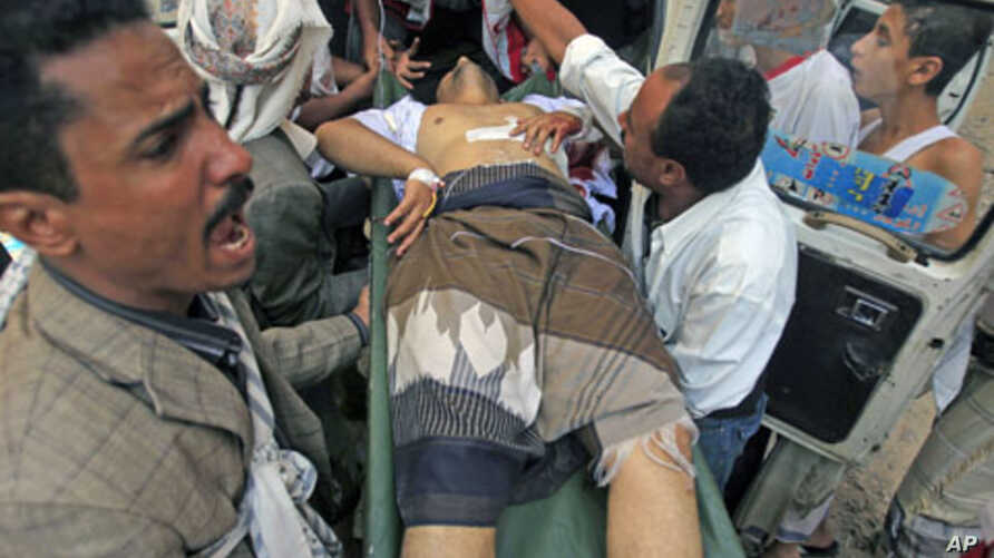 An injured opposition fighter rushed to a hospital after clashes with government security forces in the southern city of Taiz, Yemen, November 2, 2011.