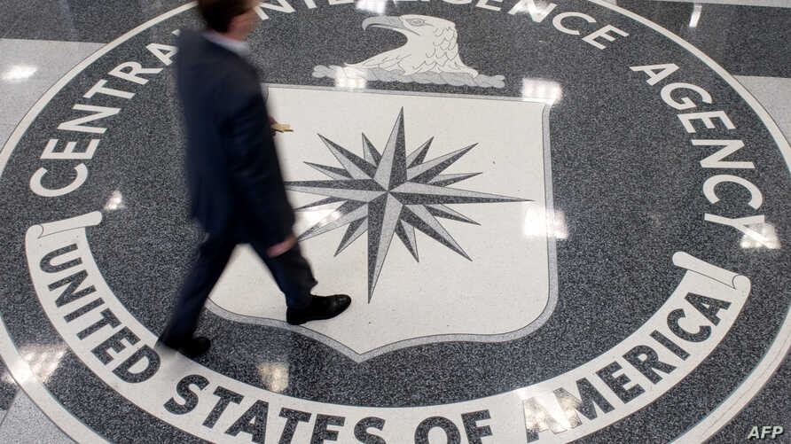 FILE - A man crosses the Central Intelligence Agency (CIA) logo in the lobby of CIA Headquarters in Langley, Virginia.