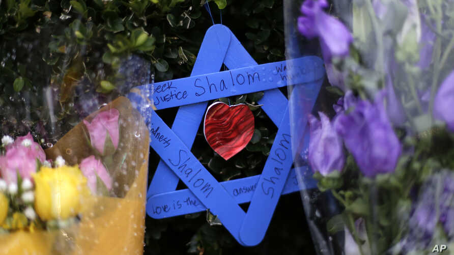 A Star of David fashioned from ice pop sticks hangs from bushes outside the Tree of Life Synagogue in Pittsburgh, Nov. 20, 2018.