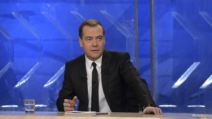 Russian Prime Minister Dmitry Medvedev gives an interview to federal TV channels at the Ostankino TV Center In Moscow, Dec. 6, 2013.