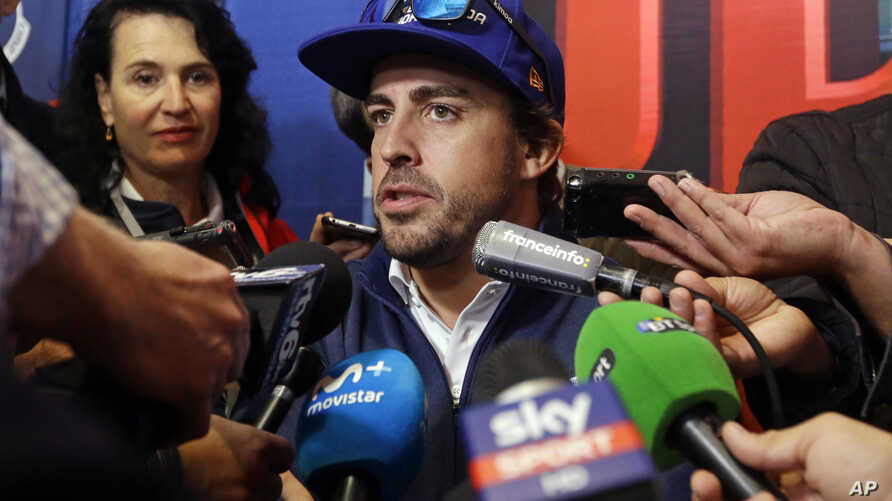 Fernando Alonso, of Spain, answers a question during a press conference for the Indianapolis 500 auto race at Indianapolis Motor Speedway, May 25, 2017, in Indianapolis.