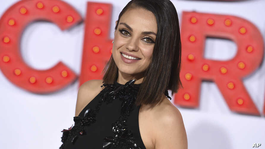 "FILE - Mila Kunis arrives at the Los Angeles premiere of ""A Bad Moms Christmas,"" Oct. 30, 2017. Kunis has been named Woman of the Year by Harvard University's Hasty Pudding Theatricals."