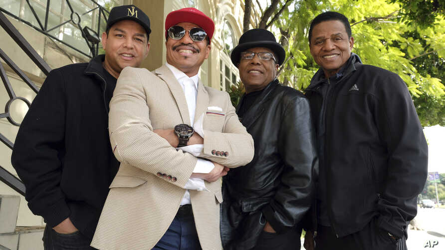 Marlon Jackson, 2nd from left, Tito Jackson, 2nd from right, and Jackie Jackson, far right, brothers of the late musical artist Michael Jackson, and Tito's son Taj, far left, pose together for a portrait outside the Four Seasons Hotel, in Los Angeles