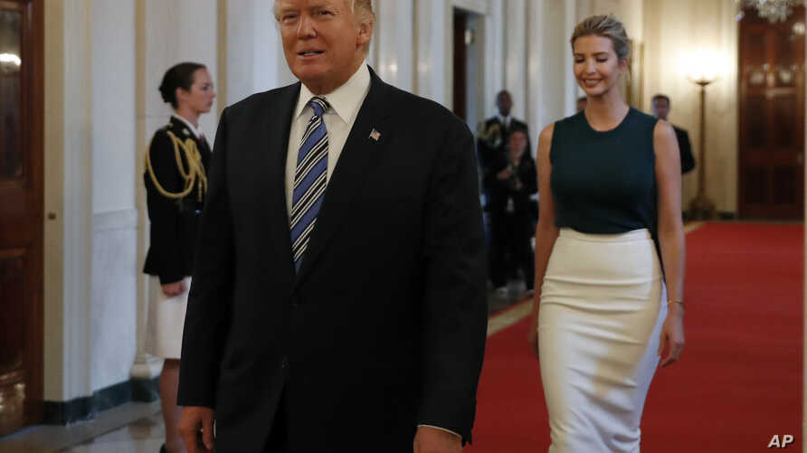 """President Donald Trump, followed by his daughter Ivanka Trump, walks to the East Room of the White House in Washington, Tuesday, Aug. 1, 2017, to speak with small business owners as part of """"American Dream Week."""""""