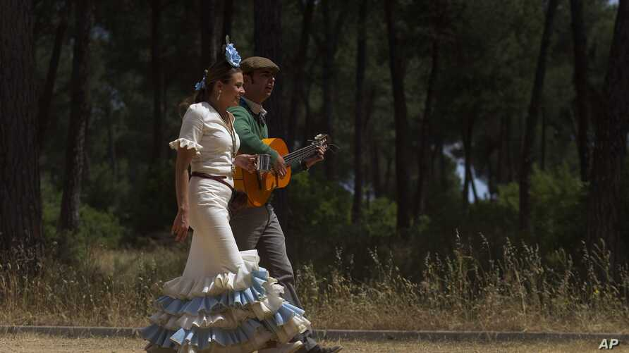 FILE - A couple is seen in the countryside of Almonte in Huelva province, Andalusia, Spain.