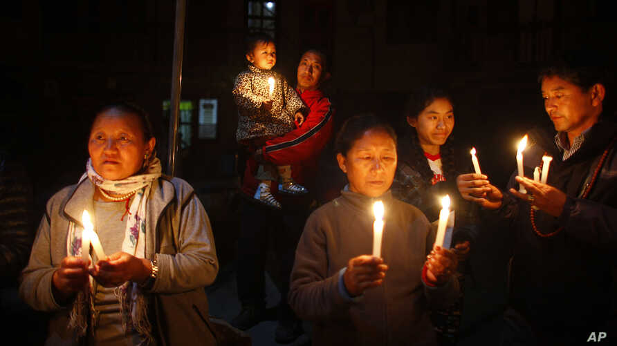 Exile Tibetans participate in a candle light vigil in solidarity with fellow Tibetans who have self immolated, in Katmandu, Nepal, February 13, 2013.