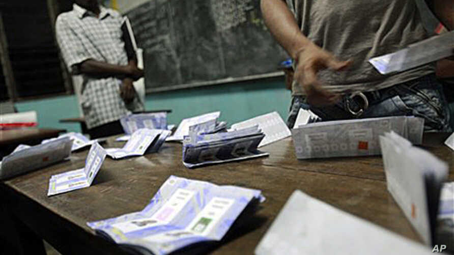 Poll workers finish counting votes at a polling station in the Treichville neighborhood of Abidjan, Ivory Coast, 28 Nov. 2010