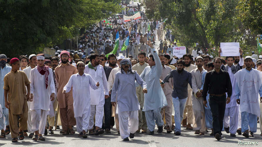 Protesters shout slogans as they march towards the U.S. Embassy during an anti-America rally in Islamabad, September 21, 2012..