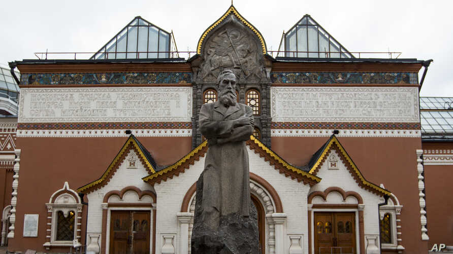 A view of the Tretyakov State Gallery museum with the statue of the founder of the gallery Pavel Tretyakov in the center in Moscow, Feb. 11, 2016. Police arrested a man on charges of vandalizing a famous painting by renowned Russian artist Ilya Repin