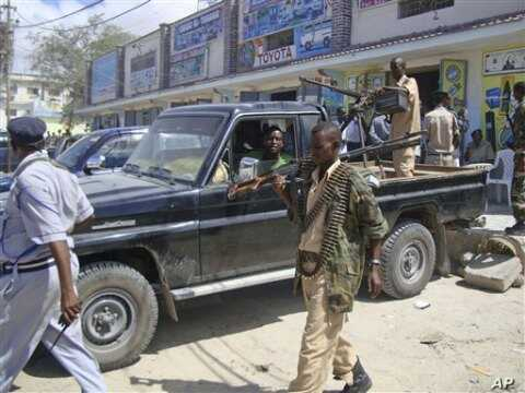Somali security officials patrol near southern Mogadishu's K4 intersection conducting operations to ensure security, May 9, 2011