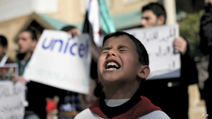 A Syrian boy chants slogans during a rally demanding UNICEF to protect Syrian children in front of the UNICEF Compound in Amman, Jordan, February 20, 2012.