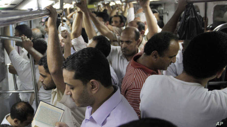 Egyptian man recites versus from the Quran at an underground metro after a massive power cut has hit large parts of Cairo, Egypt, August 9, 2012.