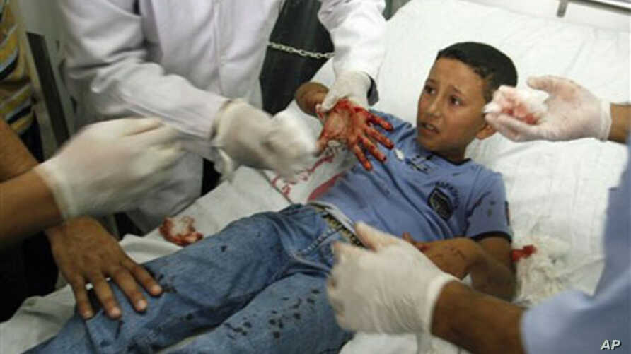 A Palestinian schoolboy injured in the blast receives treatment at a hospital in the southern Gaza strip town of Rafah, 20 Oct 2010