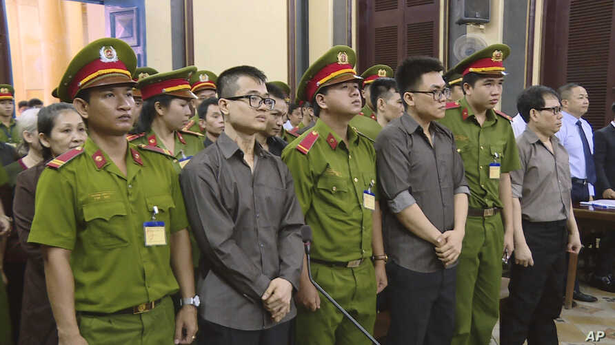 Members of the Provisional Central Government of Vietnam in exile in the United States stand trial in Ho Chi Minh City, Vietnam, Aug. 21, 2018. (Vietnam News Agency/Thanh Chung via AP)