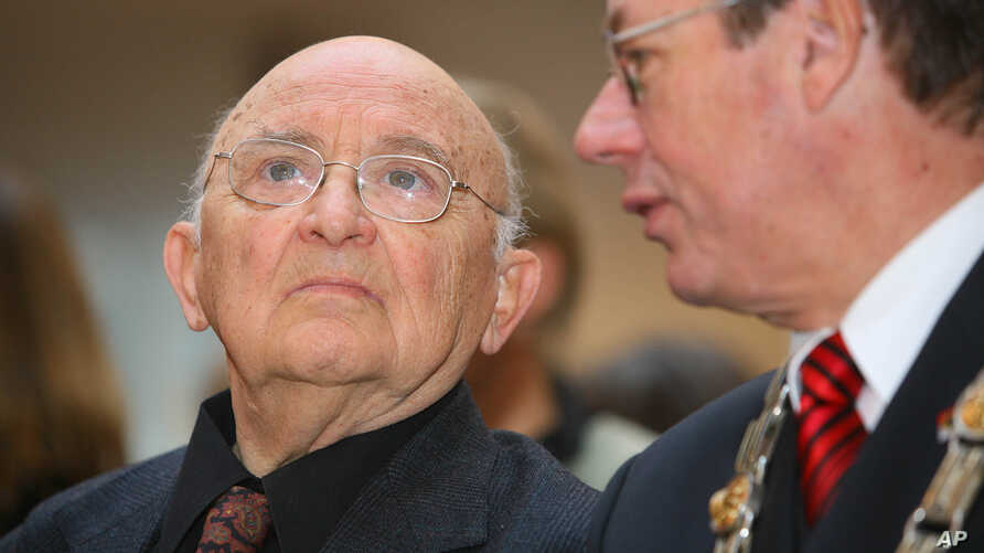 Israeli author Aharon Appelfeld, left, sits next to Dortmund's mayor, Gerhard Langemeyer, during the award ceremony of the Nelly-Sachs award for Appelfeld's career in Dortmund, Germany, Dec. 4, 2005.