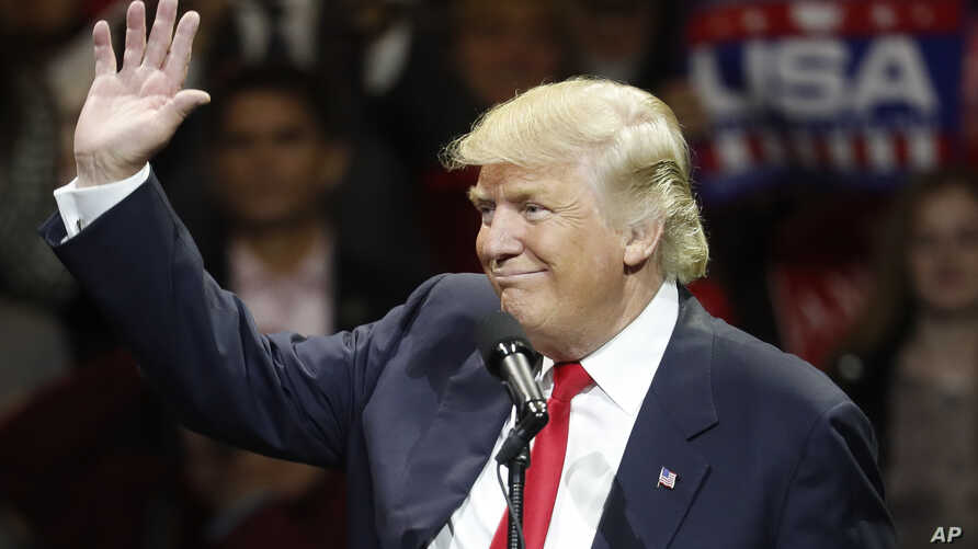 President-elect Donald Trump waves and smiles as he speaks during the first stop of his post-election tour, Dec. 1, 2016, in Cincinnati, Ohio.