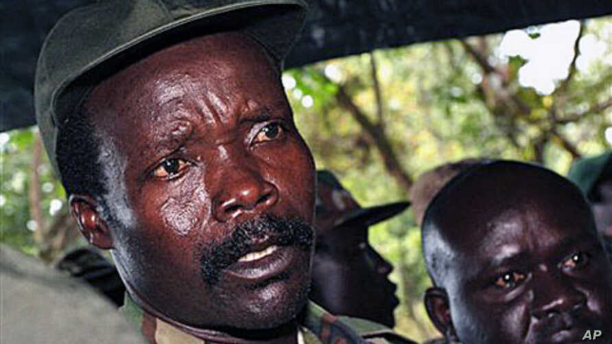 The leader of the Lord's Resistance Army, Joseph Kony, answers journalists' questions following a meeting with UN officials in southern Sudan, Nov 2006 (file photo)
