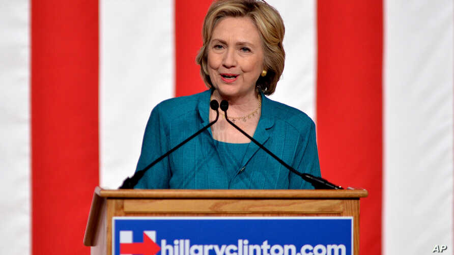 FILE - In this Friday, July 31, 2015, Democratic presidential candidate, former Secretary of State Hillary Rodham Clinton, calls on Congress to end the trade embargo the U.S. has imposed against Cuba since 1962, during a campaign stop at Florida Inte