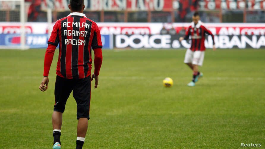 AC Milan's Kevin Prince Boateng (L), wearing a jersey against racism, and Stephan El Shaarawy warm up before their match against Siena in Milan Jan. 6, 2013.